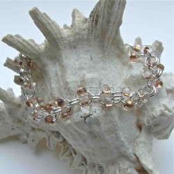 Chain bracelet with copper farfalle beads