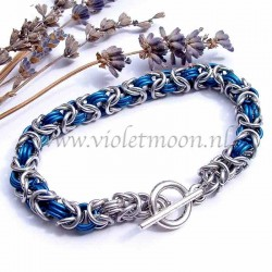 Byzantine chain maille bracelet in bare and blue anodised aluminum rings.