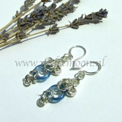 Chain maille earrings with blue glass rings.