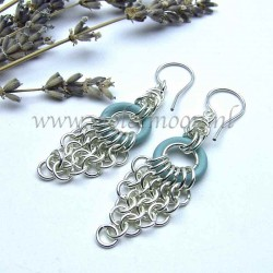 Chain maille earrings with blue rubber rings.