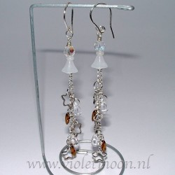 Earrings Sterre, super long earrings that start as a milky-white flower and end in a waterfall of metal stars, transparent drops and brown metalic dagger beads.