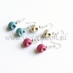 Howlite skull earrings.