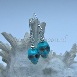 Turquoise Howlite skull earrings.
