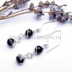 Earrings Sienna, black earrings, non tarnish silver plated artistic wire, silverplated bead caps and wire wrapped black glass pearls.