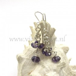 Chain maille earrings with purple beads.