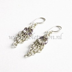 Chain maille earrings with purple glass rings.