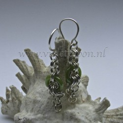 Chain maille earrings with green glass rings.