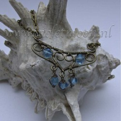 Machteld, a romantic necklace with a wire wrapped pendant made from gun metal artistic wire